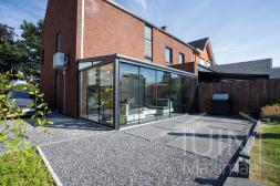 Moderne Gumax® Terrassenüberdachung in mat antraciet 6,06 meter und 3 meter mit Türgriffe